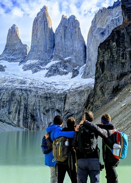 Group travel hiking in Torres Del Paine National Park in Patagonia