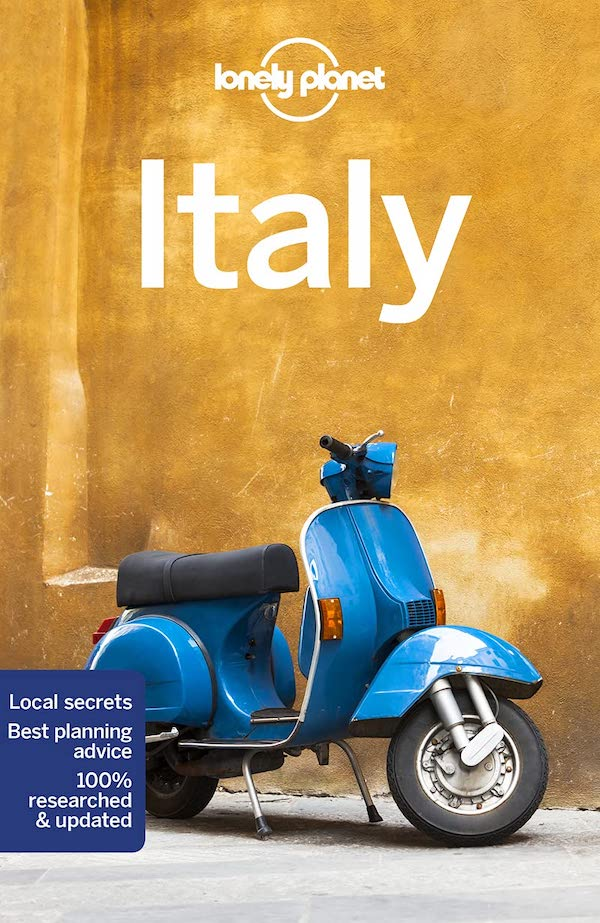 lonely planet italy guidebook. book cover has a blue vespa against a mustard yellow wall