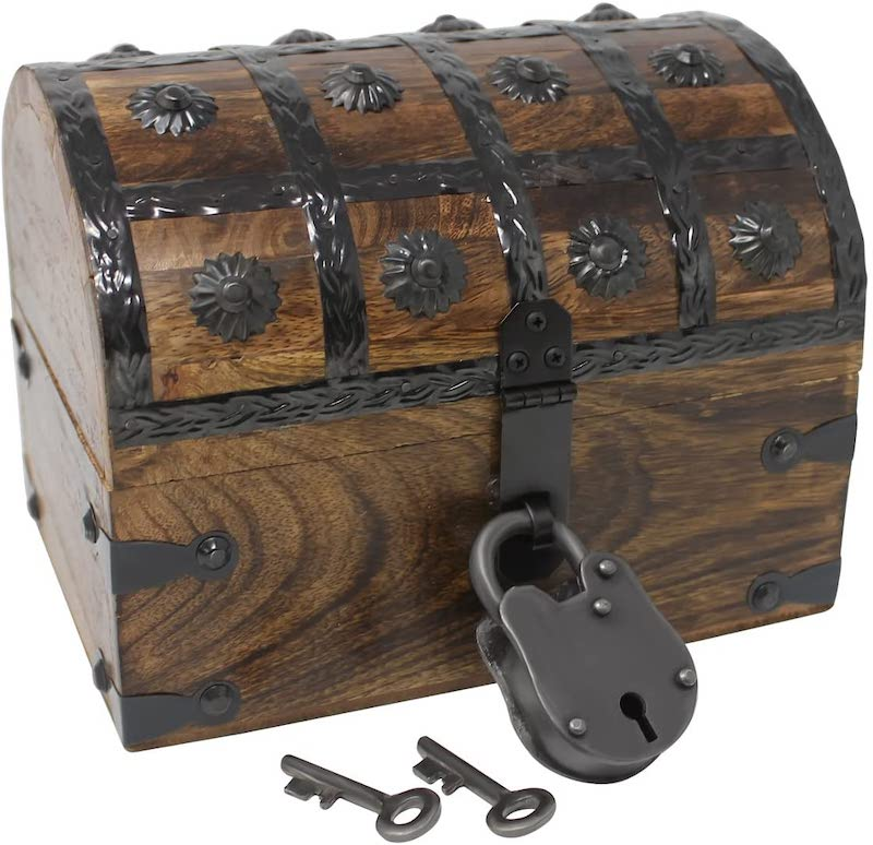 small dark brown treasure chest with dark metal finishes on trunk hood and latch lock and keys.
